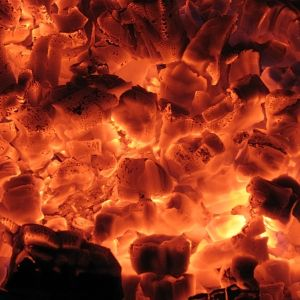 Glowing embers in a fireplace
